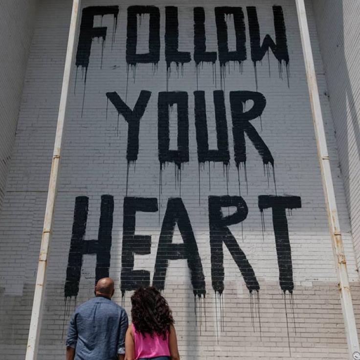 @eddieandpattyphotos - Couple viewing Follow Your Heart street mural at Union Market - Street art in Washington, DC