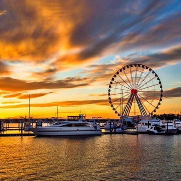 @serothphotography - Sunset and boats docked by the Capital Wheel at National Harbor - Maryland