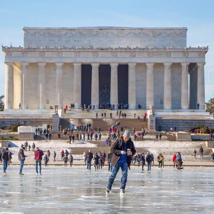 @transplantedindc - Man skating on frozen Lincoln Memorial Reflecting Pool - Winter in Washington, DC